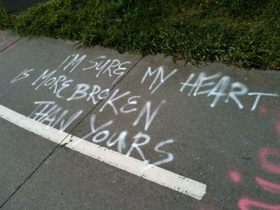 "Grafitti on path ""I'm sure my heart is more broken than yours"""