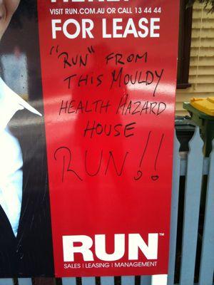 Defaced Run property sign – close up